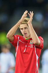 HELSINKI, FINLAND - Saturday, October 10, 2009: Wales' David Edwards applauds the travelling supporters after his side's 2-1 defeat by Finland during the 2010 FIFA World Cup Qualifying Group 4 match at the Olympic Stadium. (Pic by David Rawcliffe/Propaganda)