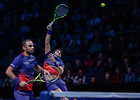 Tennis - 2019 Nitto ATP Finals at The O2 - Day Six<br /> <br /> Doubles Group Max Mirnyi: Juan Sebastien Cabal (COL) & Robert Farah (CAN) Vs. Kevin Krawietz (GER) & Andreas Mies (GER)<br /> <br /> Robert Farah (COL) leans back as he drives home the smash <br /> <br /> <br /> COLORSPORT/DANIEL BEARHAM