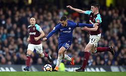 Chelsea's Eden Hazard (centre) and West Ham United's Declan Rice (right) battle for the ball during the Premier League match at Stamford Bridge, London.