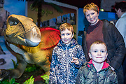 NO FEE PICTURES<br /> 17/12/17 Sinead Crowley and sons Seamus, 5 and Conor Phelan, 8 pictured at the prehistoric preview and official opening of Dinosaurs Around The World now open at the the Ambassador Theatre  for a limited time only. Embark on a globetrotting expedition around the world to discover the Age of Reptiles! With advanced animatronics, a multi-layered narrative, fossils, authentic casts, cutting-edge research and immersive design elements you'll experience the Age of Reptiles as it comes to life!  Dinosaurs Around the World is open daily to the public from 10 a.m. with last entry at 6pm for a limited time only. Tickets available from Ticketmaster.ie and from the Ambassador Theatre Box Office now. Visit www.mcd.ie for more. Pictures: Arthur Carron