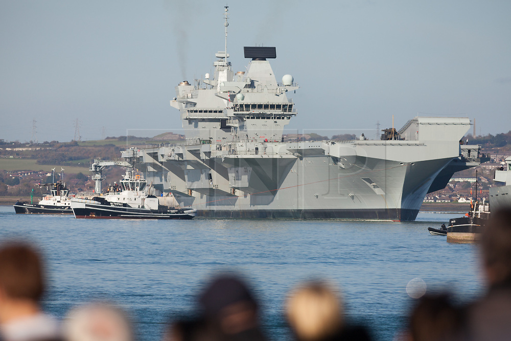 © Licensed to London News Pictures. 30/10/2017. Portsmouth, UK.  The Royal Navy's flagship, HMS Queen Elizabeth, departs Her Majesty's Naval Base (HMNB) Portsmouth for the first time since her arrival on 16/08/2017.  The new aircraft carrier is heading back to sea for the second stages of her sea trials.<br /> <br /> Flight trials involving the new F-35B Joint Strike Fighter are expected to take place off the coast of the U.S. next year, and she is due to come into service in the early 2020s.  Photo credit: Rob Arnold/LNP