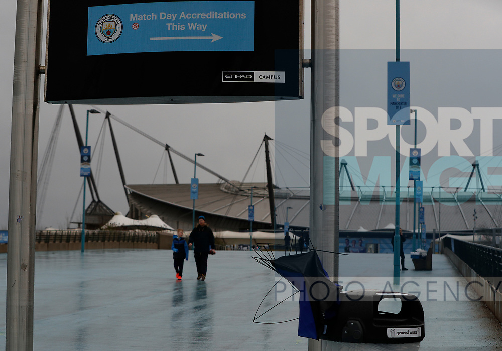 A broke umbrella pokes from a rubbish bin after the Premier League match between Manchester City and West Ham United was postponed because of weather conditions at the Etihad Stadium, Manchester. Picture date: 9th February 2020. Picture credit should read: Darren Staples/Sportimage