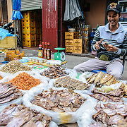 Dried squid, shrimp, and fish for sale at the morning market in Luang Prabang, Laos.