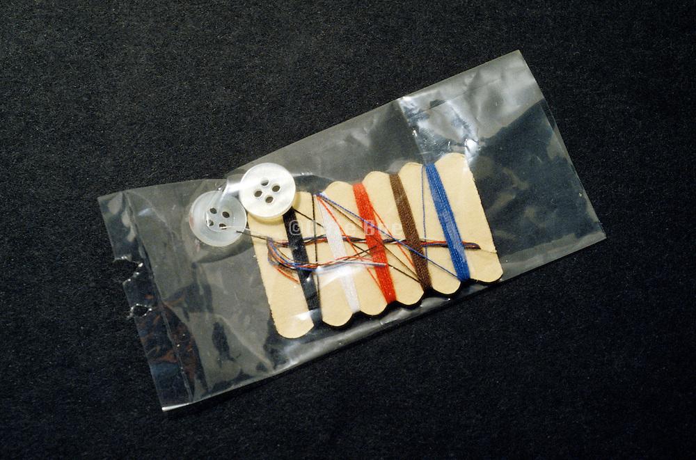 small sewing repair kit in plastic bag