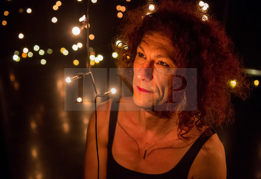 """© Licensed to London News Pictures. 29/11/2018. Bristol, UK. Art installation at the Arnolfini Gallery titled """"We Are Warriors"""", marking 100 years of Women's Suffrage, the right to vote. Picture of LOTTIE LOU, who did sound and light technical support on the installation. After a year's work commemorating 100 years of Women's suffrage, Bristol Women's Voice and and the Government Equalities Office commissioned In Between Time to make a light and sound installation at Arnolfini. Created by Helen Cole, Artistic Director of In Between Time, the instillation is made up of thousands of LED lights with each individual light representing an individual woman. One hundred Bristolian women, aged 8-85 contributed their sounds at workshops led by In Between Time and Breathing Fire in a range of settings from schools, a prison, domestic violence support groups to a Women's Institute group. These lights adorn the walls, floors and ceilings of a darkened space in Arnolfini, making for a truly spectacular visual image that is both beautiful and poignant. Every woman visiting the exhibition will also be invited to create their own LED light at Arnolfini, before adding their light to the existing light installation; as a show of strength and support for the centenary of the women's suffrage movement. The exhibition will be open to the public from the 1 – 16 December. Photo credit: Simon Chapman/LNP"""
