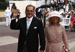 File photo dated 02/07/11 of Sir Roger Moore and wife Kristina arriving for the wedding of Prince Albert II of Monaco and Charlene Wittstock at the Place du Palais. Sir Roger has died in Switzerland after a short battle with cancer, his family has announced.