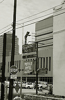 Old Pueblo Hotel and Apartments sign before restoration with construction ongoing of the TEP building