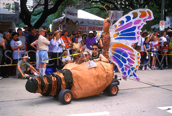 Stock photo of a woman and girl riding in the butterfly car