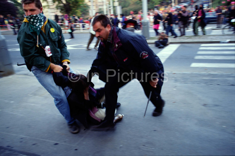 Police snatch squad arrest a rioter during the Anti Globalisation riots Prague, Czech Republic