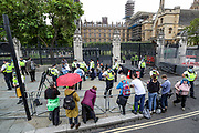 A group of Extinction Rebellion activists glued themselves by the main entrance of the Houses of Parliament, outside Westminster Palace on Thursday, Sept 3, 2020. Environmental non-violent activists group Extinction Rebellion enters its 3rd day of continuous ten days to disrupt political institutions throughout peaceful actions swarming central London into a standoff, demanding that central government obeys and delivers Climate Emergency bill.