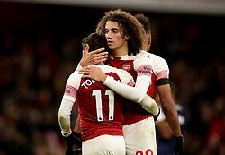 Arsenal's Matteo Guendouzi (back) and Arsenal's Lucas Torreira (front) celebrate after the final whistle