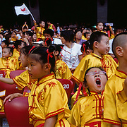 Young chinese children become tired and restless during events at the Olympic Stadium, Beijing, during the summer Olympic Games.  August 8 to August 24, 2008. Photo Tim Clayton