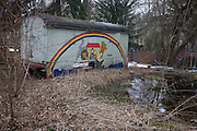 A former railway freight wagon has been painted with childrens' colours and left in a playground, near a pond in Wedding, a north-western district of Berlin.