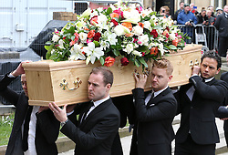 © Licensed to London News Pictures . 18/03/2016 . Manchester , UK . L to R Jack P. Shepherd, Alan Halsall, Mikey North and Ryan Thomas carrying the coffin in to the church. Television stars and members of the public attend the funeral of Coronation Street creator Tony Warren at Manchester Cathedral . Photo credit : Joel Goodman/LNP