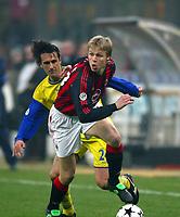 Milano 9/3/2003<br />Milan - Chievo 0-0<br />Martin Laursen inseguito da Federico Cossato