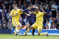 Photo: Olly Greenwood.<br />Southend United v Sheffield Wednesday. Coca Cola Championship. 09/09/2006. Southend's Billy Paynter is tackled by Sheffield's Majid Bougherra and Frank Simek (L).
