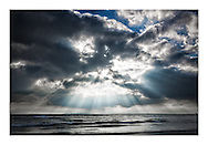 Sun rays through a dramatic sky at West Wittering beach, Sussex. <br /> Photograph by Christopher Ison ©<br /> 07544044177<br /> chris@christopherison.com<br /> www.christopherison.com