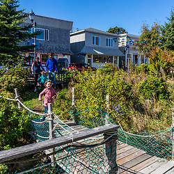 A family explores a fishing museum housed in historic fish processing buildings in Lubec, Maine.