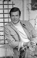 British actor Roger Moore seen at his home in Buckinghamshire in 1977. He played the part of James Bond. Photographed by Terry Fincher