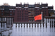 A Chinese flag flies in front of the Potala  Palace in Lhasa.