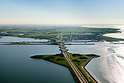 Nederland, Noord-Holland, Den Oever, 07-05-2018; begin Afsluitdijk met Stevinsluizen (spuisluizen, en de schutsluis). Haven Den Oever, rechts Waddenzee. <br /> Beginning Enclosure Dam with Stevin Sluices and lock. Waddenzee (right).<br /> <br /> luchtfoto (toeslag op standard tarieven);<br /> aerial photo (additional fee required);<br /> copyright foto/photo Siebe Swart