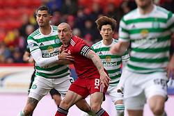 Celtic's Nir Bitton (left) and Aberdeen's Scott Brown battle in the penalty area during the cinch Premiership match at Pittodrie Stadium, Aberdeen. Picture date: Sunday October 3, 2021.