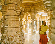 """A priest at a Jain temple. Known as the """"Golden City"""", Jaisalmer is distinguished by its yellow sandstone architecture."""