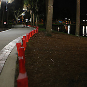 """Over 3000 luminaries were placed around Lake Eola park during the """"Marriage Equality Rally"""" at the Lake Eola bandshell in downtown Orlando, Florida on Thursday, June 27, 2013. Orlando's gay community and its supporters are celebrating the U.S. Supreme Court rulings on gay marriage and the Defense of Marriage Act (DOMA) reversal that constitutionally denied legally married gay couples federal benefits. (AP Photo/Alex Menendez)"""