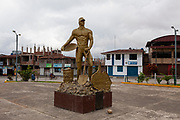 Monument dedicated to the miners who came with the hope of finding gold in Huepetuhe, Peru. Huepetuhe is a town where the largest gold extraction is concentrated within the mining corridor. in the peruvian Amazon.