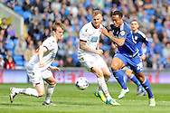 Cardiff City's Kenneth Zohore (r) takes on Bolton's David Wheater (c) and Rob Holding (l).  Skybet football league championship match, Cardiff city v Bolton Wanderers at the Cardiff city Stadium in Cardiff, South Wales on Saturday 23rd April 2016.<br /> pic by Carl Robertson, Andrew Orchard sports photography.