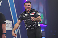 Gerwyn Price hits a double and celebrates during the William Hill World Darts Championship Final at Alexandra Palace, London, United Kingdom on 3 January 2021.