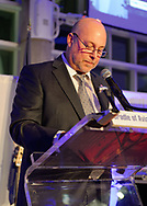 Garden City, New York, U.S.  November 14, 2019. PERRY YOUNGWALL, CEO and President of Transaero, Inc, speaks at podium about receiving the Leroy R. Grumman Award at the 17th Annual Cradle of Aviation Museum Air and Space Gala.