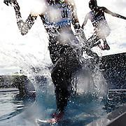 Purity Kirui, (front) and Lidya Chepkurui, Kenya, in action at the water jump in the Women's 3000m Steeplechase during the Diamond League Adidas Grand Prix at Icahn Stadium, Randall's Island, Manhattan, New York, USA. 14th June 2014. Photo Tim Clayton