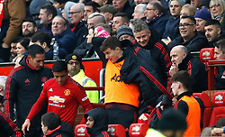 Manchester United's Alexis Sanchez (second left) moves in the dugout after sitting in the seat of interim manager Ole Gunnar Solskjaer (centre right) during the Emirates FA Cup, third round match at Old Trafford, Manchester.
