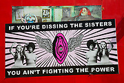 Glastonbury Festival, 2015. Shangri La is a festival of contemporary performing arts held each year within Glastonbury Festival. The theme for the 2015 Shangri La was Protest.  Women's lib poster showing sister power.