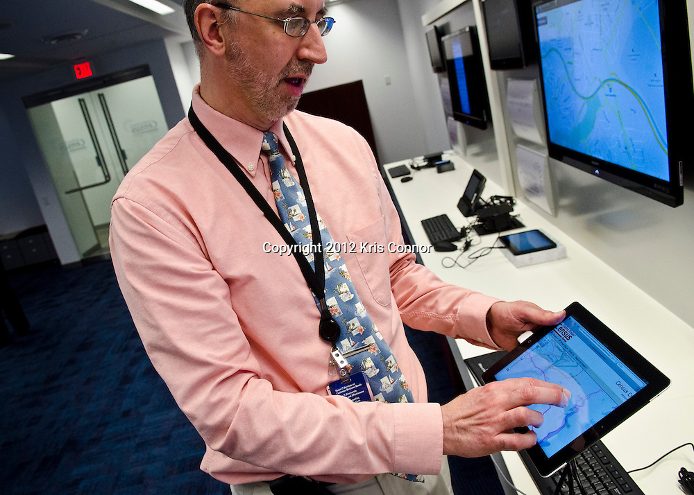 Barry F Sessamen, program manager ofcenter for applied Technology, shows how the Ipad can be used to gain data on populations demographics during a tour at the Center for Applied Technology lab at the Census Bureau headquarters in Suitland, Maryland on April 4, 2012. The bureau is looking at the Apple Ipad and other handheld devices to help get information during the 2020 census. Photo by Kris Connor