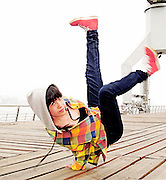 Young female breakdancing
