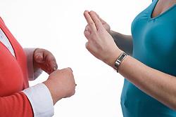 Two women using sign language to communicate,