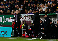 Football - 2019 / 2020 Premier League - Burnley vs. Arsenal<br /> <br /> Burnley manager Sean Dyche urges on his team as Arsenal manager Mikel Arteta looks on, at Turf Moor.<br /> <br /> <br /> COLORSPORT/ALAN MARTIN