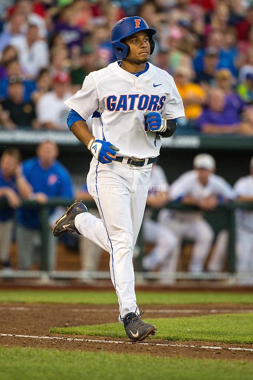 Richie Martin (12) of the Florida Gators runs during a game between the Miami Hurricanes and Florida Gators at TD Ameritrade Park on June 13, 2015 in Omaha, Nebraska. (Brace Hemmelgarn)
