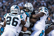 The Carolina Panthers defense tackles Oakland Raiders running back Latavius Murray (28) at Oakland Coliseum in Oakland, Calif., on November 27, 2016. (Stan Olszewski/Special to S.F. Examiner)