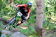Dylan Crane competes in Stage 4 of the Keystone Big Mountain Enduro in Keystone, CO. ©Brett Wilhelm