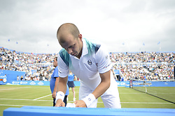 June 24, 2017 - London, England, United Kingdom - Gilles Muller of Luxembourg, changes his top in the semi final of AEGON Championships at Queen's Club, London, on June 24, 2017. (Credit Image: © Alberto Pezzali/NurPhoto via ZUMA Press)