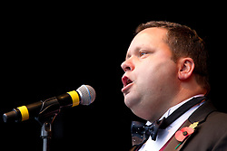 © Licensed to London News Pictures. 11/11/2013. London, UK. Opera singer and 'Britain's Got Talent' winner Paul Potts sings during a the 'Silence in the Square' ceremony, held by the Royal British Legion, in Trafalgar Square, London, today (11/11/2013). The ceremony, culminating in a two minutes silence and the placing of poppies into the square's fountains, is held on the 11th hour of the 11th day to commemorate the signing of the armistice that ended the First World War. Photo credit: Matt Cetti-Roberts/LNP