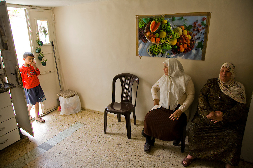 Palestinian guide and driver Abdul-Baset Razem's son with his aunt and grandmother at their home in a Palestinean village in East Jerusalem. (Abdul-Baset Razem is featured in the book What I Eat: Around the World in 80 Diets.)