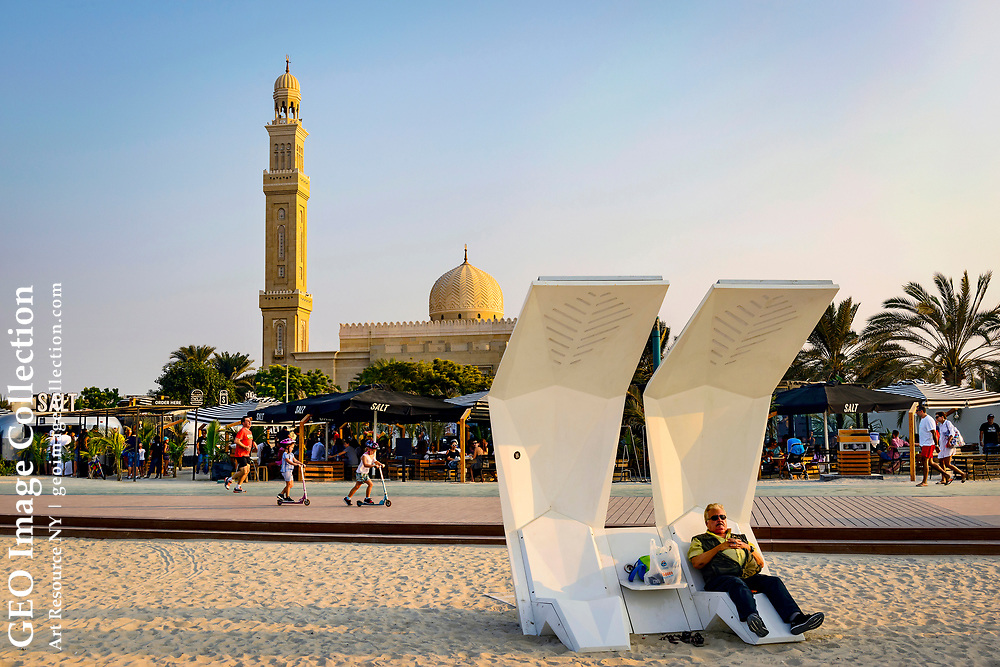 Expatriate workers, tourists, and local Arabs relax on Kite Beach in the Jumeirah neighborhood of Dubai.  The 14-kilometer-long (8.6 mile) stretch of white sand is perhaps Dubai's most popular free beach, particularly on Fridays—the Muslim day of rest.