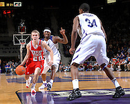 Texas Tech guard Alan Voskiul (20) drives the lane against pressure from Kansas State's Akeem Wright (34) during the first half at Bramlage Coliseum in Manhattan, Kansas, January 8, 2007.  Texas Tech defeated K-State 62-52.
