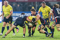 John Quill  (R) and Phillip Thiel (L) of USA tries to stop Mihaita LazarOtar Turashvili (C) of Romania during their  rugby test match between Romania and USA, on National Stadium Arc de Triomphe in Bucharest, November 8, 2014.  Romania lose the match against USA, final score 17-27.