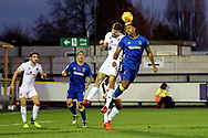 AFC Wimbledon midfielder Liam Trotter (14) battles for possession with Walsall defender Jon Guthrie (5) during the EFL Sky Bet League 1 match between AFC Wimbledon and Walsall at the Cherry Red Records Stadium, Kingston, England on 25 November 2017. Photo by Matthew Redman.