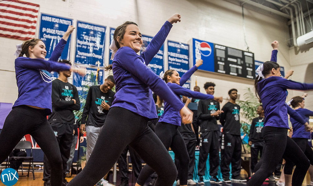 Cox Mill cheerleaders perform during a rally honoring the basketball team's 3A Basketball State Championship at Harris Road Middle School Thursday afternoon.